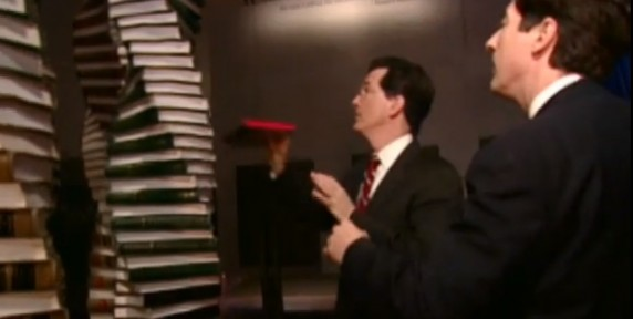 Stephen Colbert attempts to add his book to the Tower of Law exhibit at the National Constitution Center.