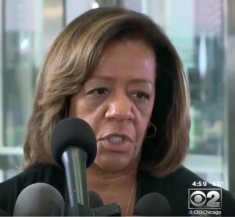 Bennett-Byrd, addressing the press after pleading guilty to fraud. (Via Youtube)