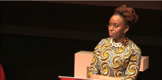 Adichie during her 2013 TED Talk. Image via YouTube