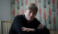 Novelist Michel Faber throws the book---his---at British P.M. David Cameron