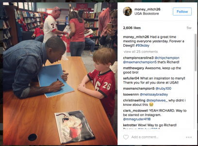 Malcolm Mitchell signing a copy of his book at the UGA Bookstore. Image via Instagram