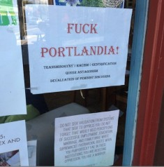 The sign will remain in the window of Portland's In Other Words. Via Willamette Weekly.
