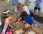 Local girl makes good, gives books to kids