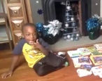 An adorable child is livestreamed by his parents reading 100 books in a single day