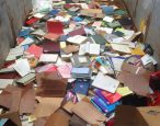 Keep books out of your trash cans, please