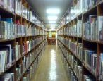 On the cosmic and bureaucratic implications of library book borrowing limits